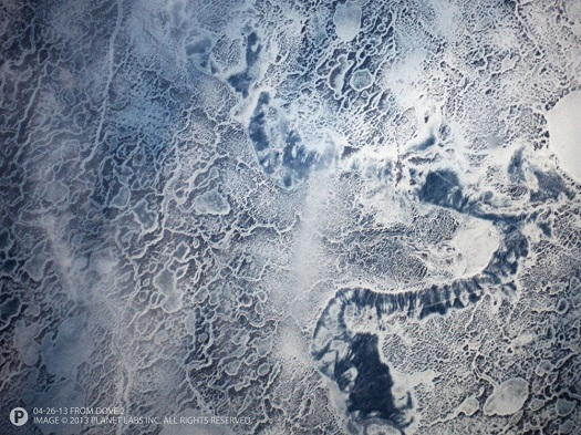 This image of sea ice in the Gulf of Bothnia off the coast of Lulea, Sweden was taken on April 26, 2013 by the Planet Labs Dove 2 satellite, a predecessor of the Flock 1 Earth-imaging constellation of small satellites. Data collected by Flock 1 will be universally accessible. (Credit: Planet Labs)