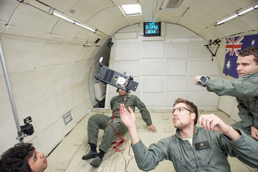 Saber Astronautics employees test their DragEN satellite de-orbiting tether in microgravity. (Credit: Bill Stafford)