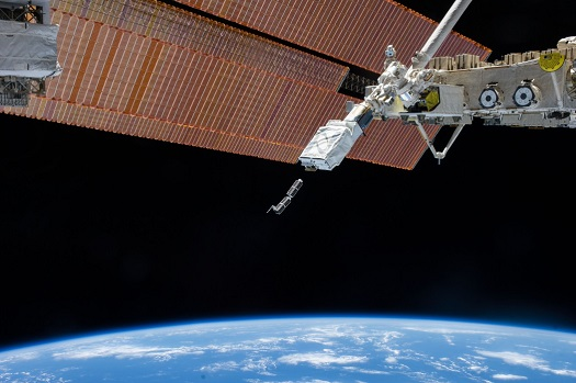 International Space Station solar array panels, Earth's horizon and the blackness of space provide the backdrop for the Feb. 11 deployment of the first of 33 small satellites using the NanoRacks CubeSat Deployer. (Credit: NASA)