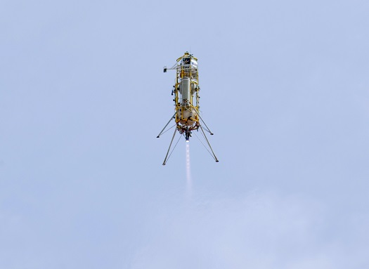 Masten Space Systems' Xombie technology demonstration test bed ascends into the Mojave Desert sky from the Mojave Air and Space Port during a March 2013 flight to validate Draper Labs' GENIE flight control system. (Credit: NASA/Tom Tschida)