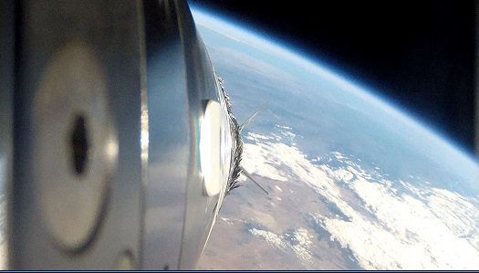 An exterior camera on the forward portion of UP Aerospace' SL-8 sounding rocket captures this spectacular view of the Earth's horizon during its flight from Spaceport America in New Mexico for NASA's Flight Opportunities Program last November. (Credit: UP Aerospace)