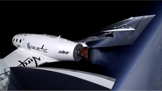 A camera mounted atop the left vertical fin of Virgin Galactic/Scaled Composites SpaceShipTwo captures the vehicle gliding through the upper atmosphere after its rocket engine is shut down during a 2013 test flight. The Earth's horizon can be seen at lower right. (Credit: Virgin Galactic)