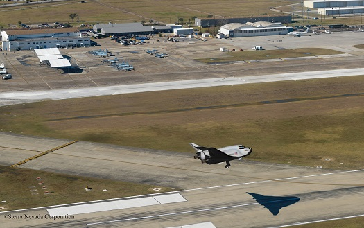 Conceptualized image of SNC's Dream Chaser® spacecraft landing on the runway at Houston's Ellington Field. (Credit: Sierra Nevada Corporation)