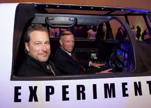 Actor and musician John Corbett and XCOR Chief Test Pilot Richard Searfoss climb aboard the Lynx replica at Celebrity Fight Night XX on Saturday, April 12th in Phoenix, Ariz. (Credit: XCOR)
