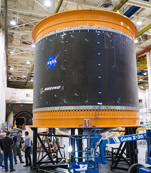 One of the largest composite rocket propellant tanks ever manufactured is prepared for transport on NASA's Super Guppy airplane. (Credit: Boeing)