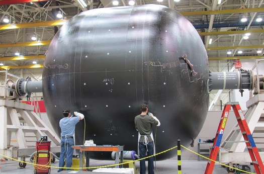 Technicians prepare the 18-foot-diameter (5.5-meter) tank during manufacturing at the Boeing Developmental Center in Tukwila, Wash. (Credit: Boeing)