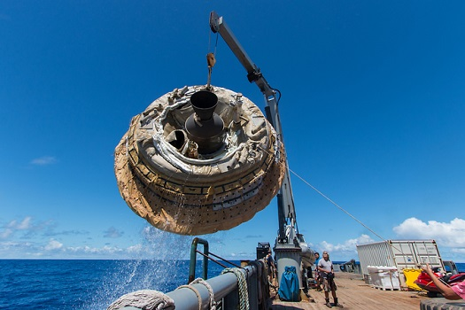 Hours after the June 28, 2014, test of NASA's Low-Density Supersonic Decelerator over the U.S. Navy's Pacific Missile Range, the saucer-shaped test vehicle is lifted aboard the Kahana recovery vessel. (Credit: NASA/JPL-Caltech)