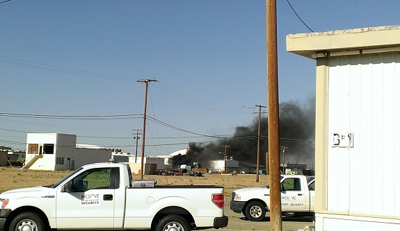 Fire outside a Virgin Galactic hangar at the Mojave Air and Space Port. (Credit: Douglas Messier)