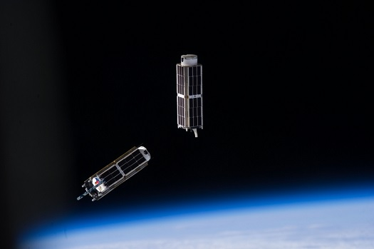 Two three-unit (3U) CubeSats. At about a foot in length and four inches wide, these are similar in design to IceCube and the five selected heliophysics CubeSats. (Credit: NASA)