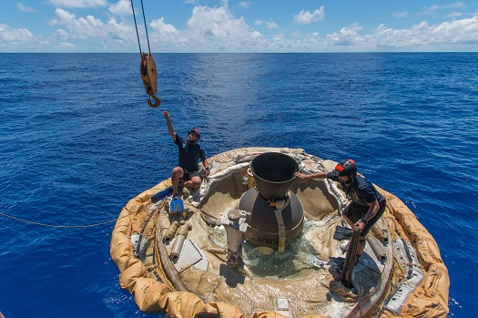 Divers retrieve the test vehicle for NASA's Low-Density Supersonic Decelerator off the coast of the U.S. Navy's Pacific Missile Range Facility in Kauai, Hawaii. (Credit:  NASA/JPL-Caltech)