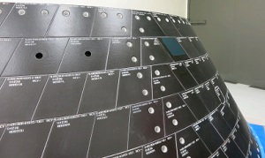 Two one-inch-wide holes have been drilled into tiles on Orion's back shell to simulate micrometeoroid orbital debris damage . Sensors on the vehicle will record how high temperatures climb inside the hole during Orion's return through Earth's atmosphere following its first flight in December. (Credit:  NASA)