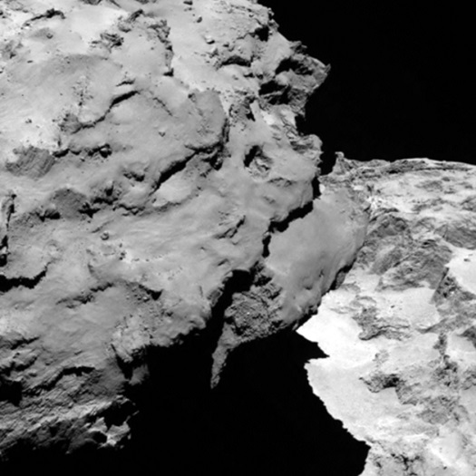 Close-up detail of comet 67P/Churyumov-Gerasimenko. The image was taken by Rosetta's OSIRIS narrow-angle camera and downloaded today, 6 August. The image shows the comet's 'head' at the left of the frame, which is casting shadow onto the 'neck' and 'body' to the right. The image was taken from a distance of 120 km and the image resolution is 2.2 metres per pixel (Credits: ESA/Rosetta/MPS for OSIRIS Team MPS/UPD/LAM/IAA/SSO/INTA/UPM/DASP/IDA)