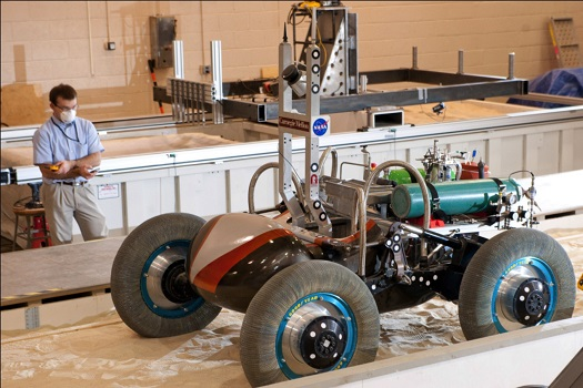 The Scarab lunar rover is one of the next generation of autonomous robotic rovers that will be used to explore dark polar craters at the lunar south pole. The rover is powered by a 100-watt fuel cell developed under the Space Power Systems Project under Game Changing Development program. Supported by NASA, the rover is being developed by the Robotics Institute of Carnegie Mellon University. (Credit:  Carnegie Mellon University)