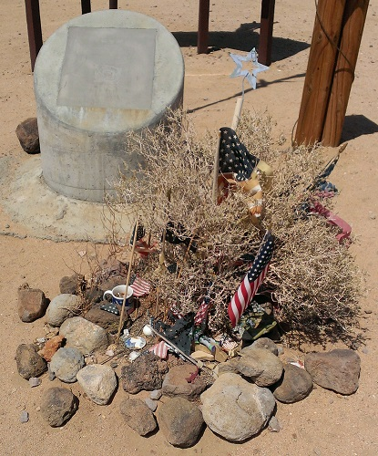 Visitor offerings at the Michael J. Adams memorial. (Credit: Douglas Messier)