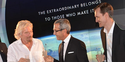 Richard Branson, GREY GOOSE creator and Maître de Chai François Thibault, and George Whitesides toast to a new partnership. (Credit: Grey Goose)
