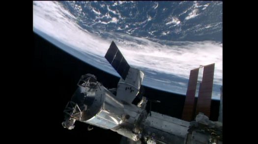 Dragon CRS-4 spacecraft berthed at the International Space Station. (Credit: NASA TV)