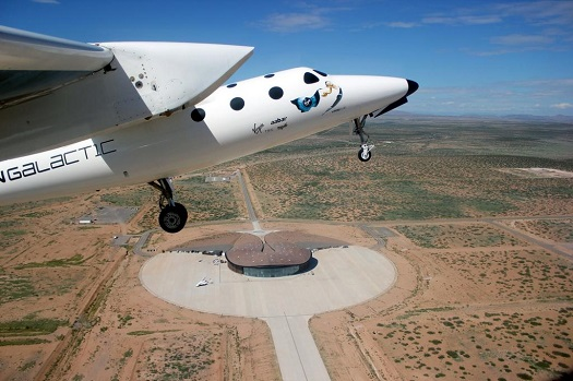 WhiteKnightTwo visited Spaceport America for the first time in three years on Wednesday. Below, you can see a full-scale model of SpaceShipTwo on the ramp. (Credit: Virgin Galactic)