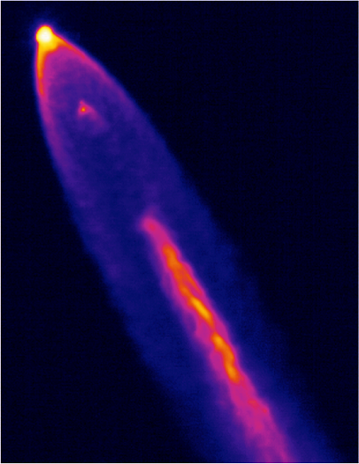 Thermal imagery of the Space X Falcon 9 first stage performing propulsive descent Sept. 21. Supersonic retropropulsion data obtained from this flight test is being analyzed by NASA to design future Mars landing systems. (Credit: NASA)