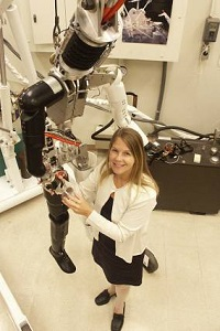 Dava Newman in the Man Vehicle Lab with the robot she uses to test next generation space suits. (Credit: William Litant)