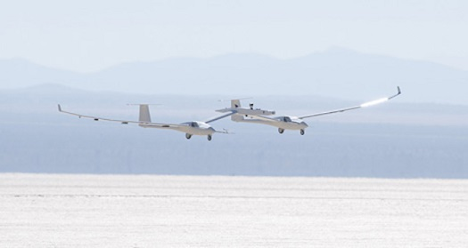 The one-third scale twin-fuselage towed glider glides in for landing on Rogers Dry Lake after its successful first test flight. (Credit: Tom Tschida/NASA Armstrong)