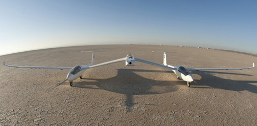 The one-third-scale twin fuselage towed glider rests of the cracked bed of Rogers Dry Lake at Edwards Air Force Base prior to its first flight Oct. 21, 2014 in this photo shot with a 16-mm. fisheye lens. (Credit: Tom Tschida/NASA Armstrong)