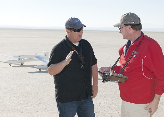 "Robert ""Red""Jensen, who piloted the towed glider, and Gerald Budd, who flew the DROID small UAV that towed the unmanned aircraft skyward, discuss flight procedures prior to takeoff. (Credit: Tom Tschida/NASA Armstrong)"