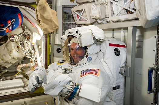 NASA astronaut Reid Wiseman checks his spacesuit in preparation for the first Expedition 41 spacewalk. (Credit:  NASA/ESA/Alexander Gerst)