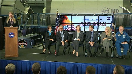 NASA's Stephanie Schierholz introduces the panel of Johnson Space Center Director Dr. Ellen Ochoa, seated, left, NASA Administrator Charles Bolden, Commercial Crew Program Manager Kathy Lueders, Boeing's John Elbon, SpaceX's Gwynne Shotwell and NASA astronaut Mike Fincke. (Credit: NASA TV)