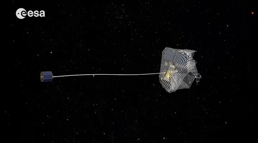 One capture concept being explored through ESA's e.Deorbit system study for Active Debris Removal - capturing the satellite in a net attached to either a flexible tether (as seen here) or a rigid connection. (Credit: ESA)