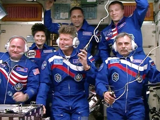 Scott Kelly, Mikhail Kornienko and Gennady Padalka joined their Expedition 43 crewmates Terry Virts, Anton Shkaplerov and Samantha Cristoforetti in the Zvezda service module for a crew greeting ceremony. (Credit: NASA)