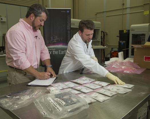 The first items ever manufactured in space with a 3-D printer were unboxed on April 6, 2015 in the Additive Manufacturing Laboratory at NASA's Marshall Space Flight Center in Huntsville, Alabama. The parts were made on the International Space Station and returned to Earth for testing at Marshall. (Credit: NASA/MSFC/Emmett Given)