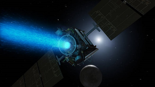Artist's concept of Dawn above Ceres around the time it was captured into orbit by the dwarf planet in early March. Since its arrival, the spacecraft turned around to point the blue glow of its ion engine in the opposite direction. (Credit: NASA/JPL-Caltech)