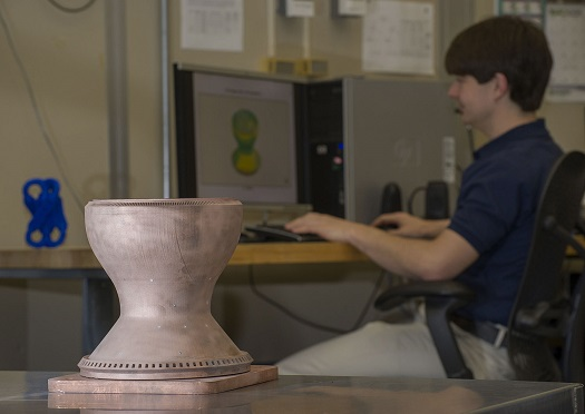 NASA engineers used 3-D printing to make the first full-scale copper engine part, a combustion chamber liner that operates at extreme temperatures and pressures. Structured light scanning, seen on the computer screen, helped verify that the part was built as it was designed. (Credit: NASA/MSFC/Emmett Given)