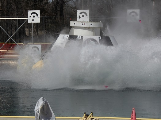 A CST-100 mock up splashes down during a test at NASA's Langley Research Center in Hampton, Va., during tests of the Boeing spacecraft's handling. (Credit: NASA/Dave Bowman)