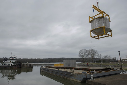 Crews lower the cryogenic tank onto a barge March 12 at NASA's dock on the Tennessee River. From there, the tank was delivered to a Dynetics test facility in Iuka, Mississippi, to verify that its structural design and manufacturing processes meet all NASA requirements. (Credit:  NASA/MSFC/Emmett Given)