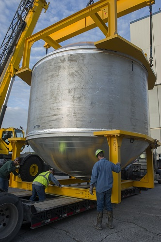 A massive cryogenic tank is loaded onto a truck at NASA's Marshall Space Flight Center to be moved to a dock on the Tennessee River in Huntsville, Alabama. (Credit: NASA/MSFC/Emmett Given)
