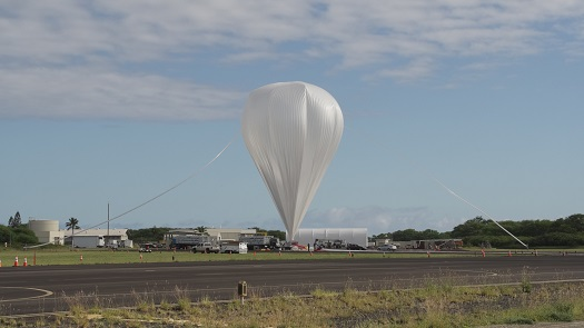 Crews from the Columbia Scientific Balloon Facility prepare the balloon for flight for the 2014 NASA Low Density Supersonic Decelerator test from the U.S. Navy Pacific Missile Range Facility on Kauai, Hawaii (Credit: NASA/Bill Rodman)