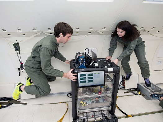 Carthage College researchers testing their propellant mass gauging experiment in zero gravity. (Credit: NASA)