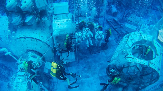 As astronaut candidates, Nicole Mann and Jessica Meir train for extravehicular activity in the Neutral Buoyancy Lab at NASA's Johnson Space Center in Houston. (Credit: NASA/B. Stafford)