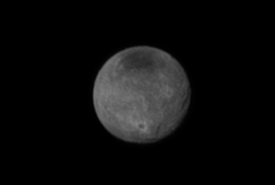 Chasms, craters, and a dark north polar region are revealed in this image of Pluto's largest moon Charon taken by New Horizons on July 11, 2015. (Credits: NASA/JHUAPL/SWRI)