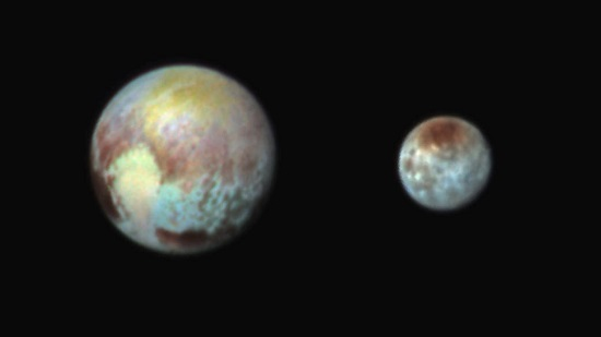 False color images of Pluto and Charon. (Credit: NASA/APL/SwRI)