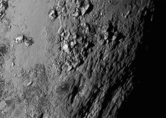 Mountains on Pluto (Credit: NASA-JHUAPL-SwRI)