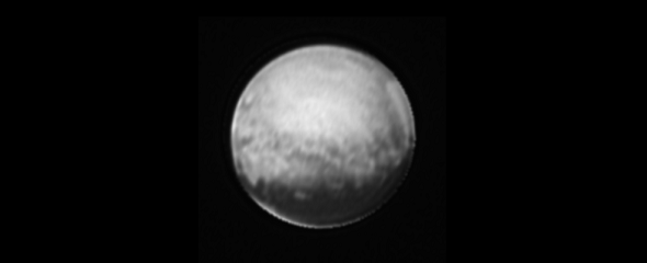 "Image of Pluto only from the New Horizons' Long Range Reconnaissance Imager (LORRI), July 8, 2015. Most of the bright features around Pluto's edge are a result of image processing, but the bright sliver below the dark ""whale,"" which is also visible in unprocessed images, is real. (Credits: NASA-JHUAPL-SWRI)"