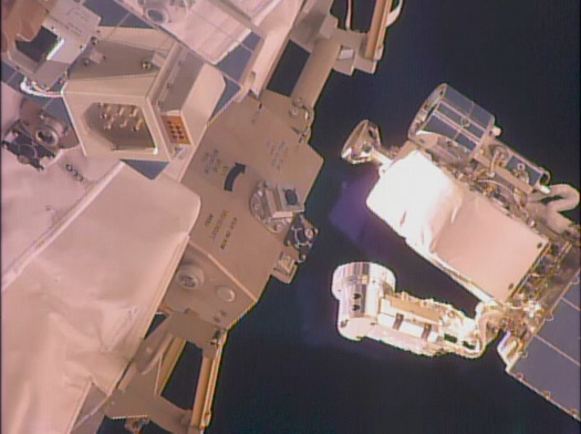 Held by the Dextre robot (not shown), the VIPIR tool (right) approaches the RRM module (left) to demonstrate the tool's video borescope. (Credit: NASA)