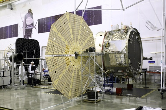The OA-4 Service Module (SM) undergoing deployment testing of one of its two UltraflexTM solar arrays at orbital ATK's Dulles, Virginia satellite manufacturing facility. Orbital ATK's Space Components Division supplies the Ultraflex arrays. (Credit: Orbital ATK)