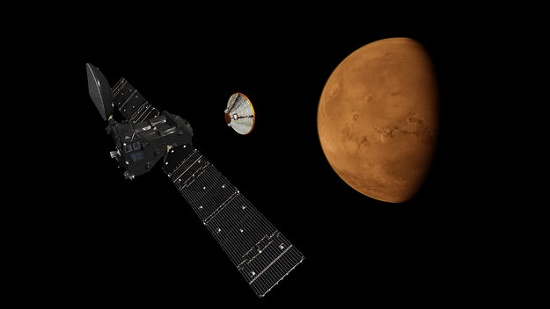 Artist's impression depicting the separation of the ExoMars 2016 entry, descent and landing demonstrator module, named Schiaparelli, from the Trace Gas Orbiter, and heading for Mars. (Credit: ESA/ATG Medialab)