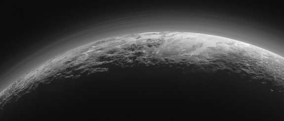 Pluto's Majestic Mountains, Frozen Plains and Foggy Hazes: Just 15 minutes after its closest approach to Pluto on July 14, 2015, NASA's New Horizons spacecraft looked back toward the sun and captured this near-sunset view of the rugged, icy mountains and flat ice plains extending to Pluto's horizon. The smooth expanse of the informally named icy plain Sputnik Planum (right) is flanked to the west (left) by rugged mountains up to 11,000 feet (3,500 meters) high, including the informally named Norgay Montes in the foreground and Hillary Montes on the skyline. To the right, east of Sputnik, rougher terrain is cut by apparent glaciers. The backlighting highlights over a dozen layers of haze in Pluto's tenuous but distended atmosphere. The image was taken from a distance of 11,000 miles (18,000 kilometers) to Pluto; the scene is 780 miles (1,250 kilometers) wide. (Credits: NASA/JHUAPL/SwRI)
