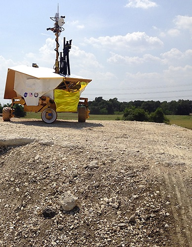 """The rover perches atop """"Mount Kosmo"""" rock yard at Johnson during its first test drive. (Credit: NASA)"""