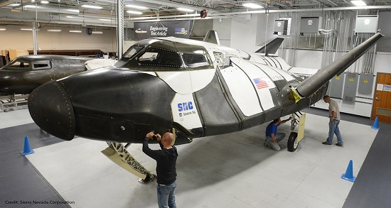 SNC technicians inspect the Dream Chaser ETA. (Credit: SNC)