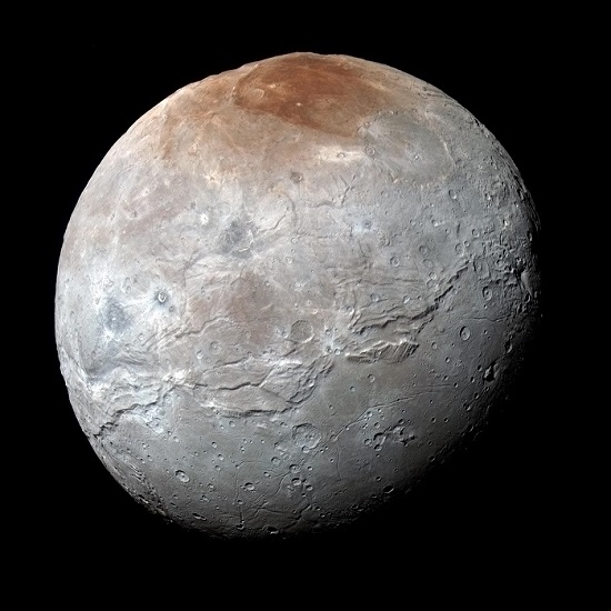 NASA's New Horizons captured this high-resolution enhanced color view of Charon just before closest approach on July 14, 2015. (Credits: NASA/JHUAPL/SwRI)